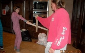 The empty-wrapping-paper-roll-sword-fight from 2010 before the youngest outgrew her mom...