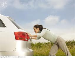 woman-pushing-car