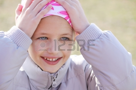 9159056-child-wearing-head-scarf-due-to-hair-los-from-chemotherapy-treatment-due-to-cancer
